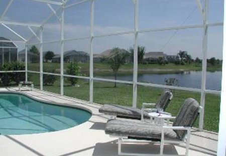 Villa in Rolling Hills, Florida: View over lanai to pool and lake beyond
