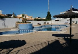 3 Bed quad townhouse, communal Pool, Free WiFi, close to beach.