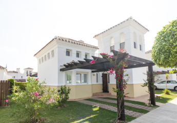 Villa in Spain, La Torre Golf Resort: Front view of villa showing car port shaded by fragrant boug..