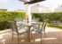 Patio area offering both shade and sun; ideal for al fresco dining