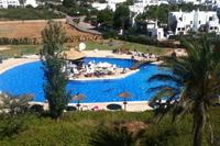 Penthouse_apartment in Spain, Cala Egos: View of pool and pool bar from roof terrace