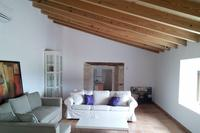 Apartment in Spain, Selva: The large lounge with sofa bed to left and window with panoramic views