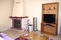 Apartment in Portugal, Tavira: Living room with fireplace.