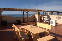 Apartment in Spain, La Azohia: Huge solarium; 180 degree views over bay, loungers, bbq and seating