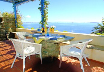 Villa in Greece, Tinos Island: large terrace wth magnificent views