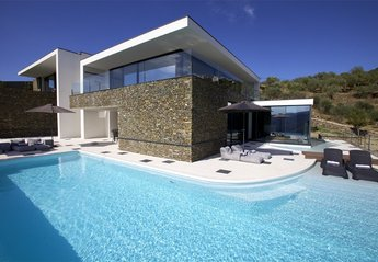 Villa in Portugal, Porto Manso: Pool terrace also showing room with Jacuzzi