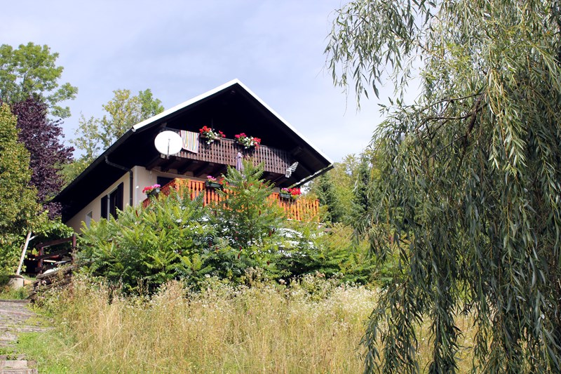 Country house in Slovenia, Kamnik: Exterior of the property from the garden in Summer.