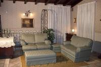 Cottage in Italy, Viagrande: THE LIVING ROOM AREA WITH THE TWO FRENCH SOFA BEDS