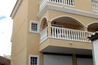 Villa in Spain, Algorfa: front of house showing balconies