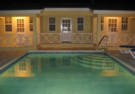 Apartment in Maxwell, Barbados: Pool by night
