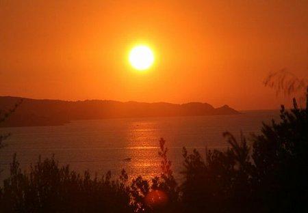 Apartment in Patrimonio, Corsica: St Florent sunset from the terrasse
