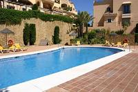 Apartment in Spain, Elviria: The large pool set in the communal gardens.