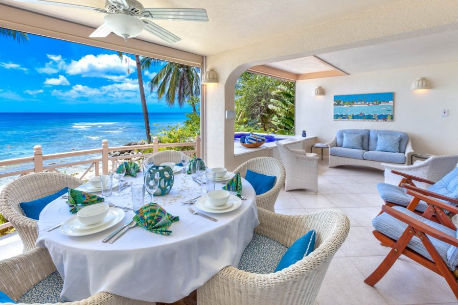 Villa in Barbados, Holetown - outside dining area with table and four chairs, sofa and armchair area and sun loungers.