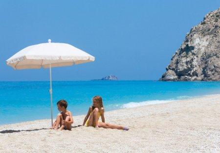 Villa in Tsoukalades, Lefkas: Two children on white beach near azure Ionian sea (Egremni, Lefkada,..