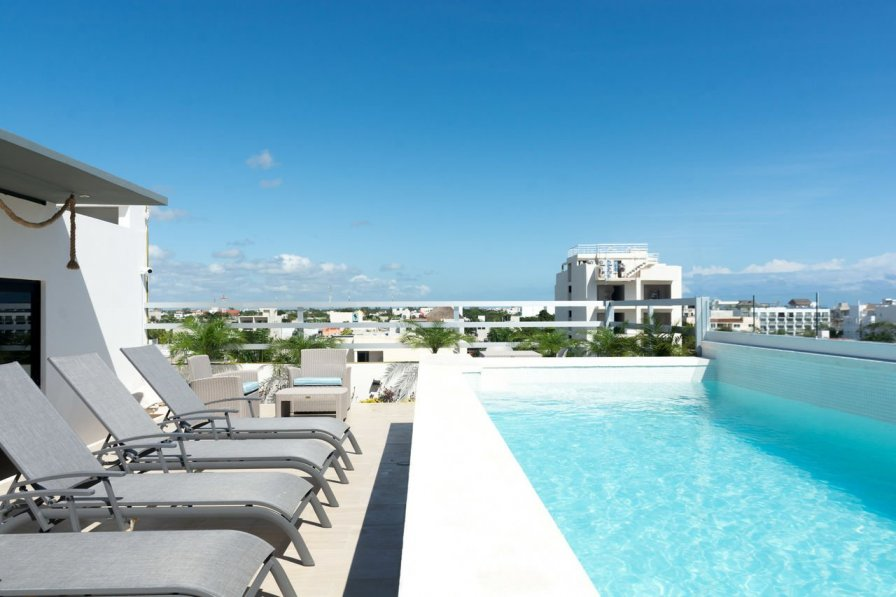 Owners abroad Tropic ➸ Airy Apartment With Beach Club Access Included