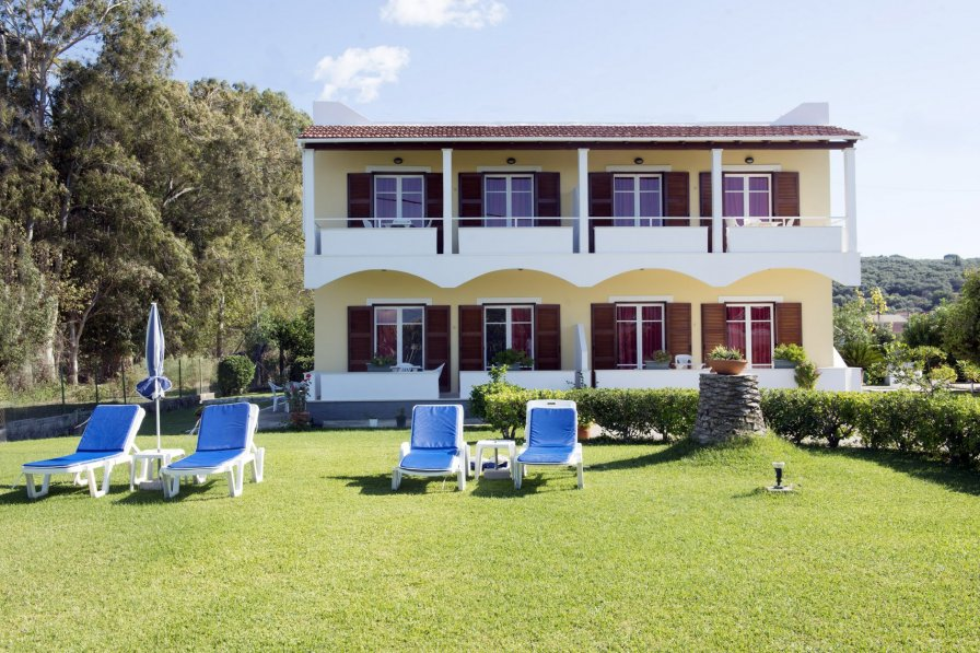 Seafront Apartment within huge lawn grounds close to a resort III