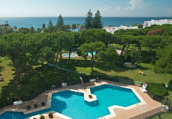 Apartment in Spain, Marbella: Partial aerial view of Club Playas Del Duque gardens and beach in Pu..