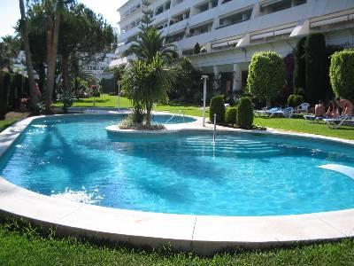 Apartment in Spain, Marbella: communal pool in beautiful gardens