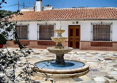 Villa in Spain, Villanueva de la Concepción: Front of the house with fountain in background
