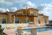 Villa in Portugal, Moncarapacho: Rear of villa, heated pool with night lights and private garden