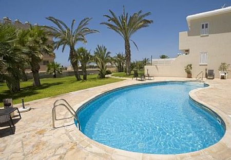Apartment in Tombs of the Kings, Cyprus: Pool Area and Gardens