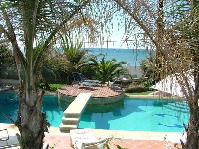 Villa in Spain, East Marbella: view to the pool and sea from the upper balcony