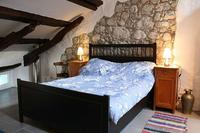 Apartment in Slovenia, Primorska: Attic Suite - Queen sized bed with antique bedside tables