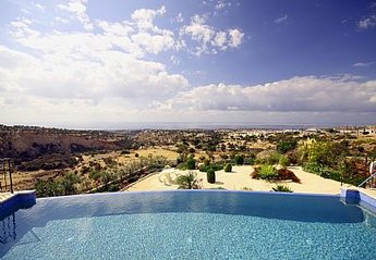 Villa in Cyprus, Peyia: Heated Infinity Overflow Swimming Pool View 1
