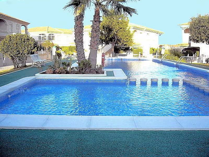 Apartment in Spain, Cabo Cervera-Playa La Mata: Lovely communal pool with surrounding sun bathing ..