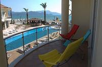 Apartment in Turkey, Calis Beach: Relax on the balcony overlooking the pool, the beach and warm Me..