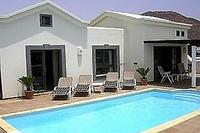 Villa in Spain, Faro Park: Villa has large pool and comfortable loungers