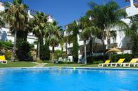 Penthouse_apartment in Spain, Selwo Hills: Pool set in tropical gardens