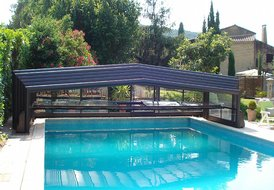 Country House in Barbentane, the South of France: the roof open  on the pool
