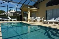 Villa in USA, Southern Dunes: Large pool deck with chairs/loungers/tables for 10 guests