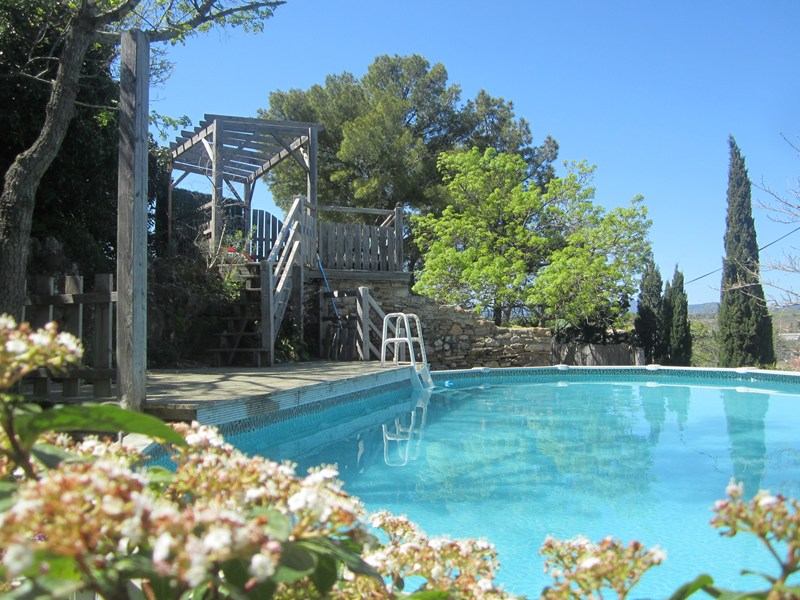 Village house in France, Fouzilhon: Below castle walls, above ground pool and sun deck have views ..