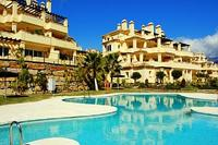 Apartment in Spain, Casares Costa: One of the swimming pools and garden area