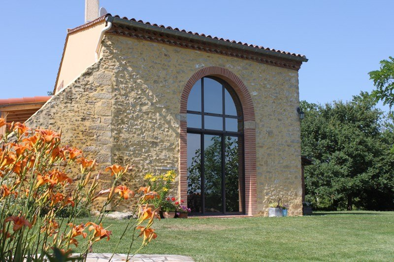 Farm house in France, Pech-Luna: Front view with double height window looking towards Pyrenees