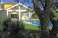 Villa in Portugal, Azeitao: View of the villa & swimming pool behind a cork tree