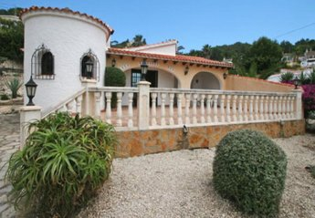 Villa in Spain, Paixi: Villa view showing 'turret' room and part of Spanish-style garden