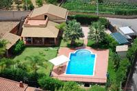 Villa in Italy, Altavilla Milicia: View of pool, villa. The garden is totally fenced!