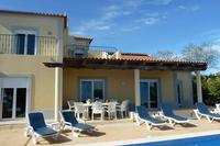 Villa in Portugal, Moncarapacho: part of rear of villa, heated pool with night lights, deep shade