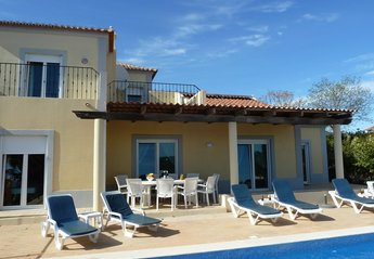 Villa in Portugal, Eastern Algarve: part of rear of villa, heated pool with night lights, deep shade