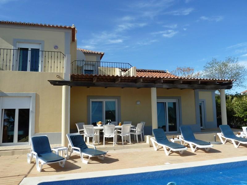 Villa in Portugal, Eastern Algarve: part of rear of villa, furnished terrace, deep shade, south fa..