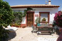 Village_house in Spain, Busot: Front patio of Bungalow with table and chairs and sun beds.