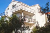 Apartment in Croatia, Milna: incredible views up the hills and across the olives to the sea