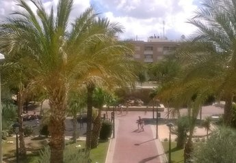 Apartment in Spain, Los Montesinos: View from the lounge window, park with waterfall, kids play area