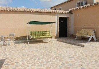 Apartment in Spain, Abanilla: comfortable lounge with range of kitchen units, tv ,
