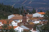 Village_house in Spain, Sierra de Aracena: Corteconcepcion skyline with local stork in residence