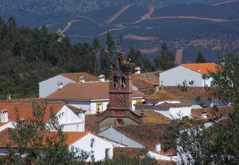 Village House in Spain, Sierra de Aracena: Corteconcepcion skyline with local stork in residence