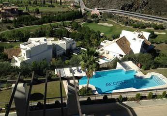 Apartment in Spain, Los Flamingos: View of one of the pools from the terrace.